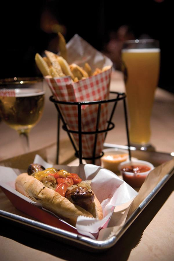 Sausage exotica: A link of buffalo, beef, pork and chipotle peppers topped with more peppers and served with fries and plenty of beer. - Anne Fishbein